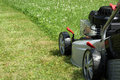 Silver lawn mower. Royalty Free Stock Photo