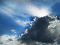Silver lining with sunbeams, rising storm clouds Royalty Free Stock Photo