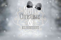 Silver merry christmas vintage card typography over defocused ba background and snowflakes Stock Photography