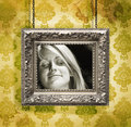 Silver picture frame against floral wallpaper Royalty Free Stock Image