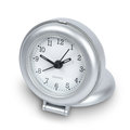 Silver plastic travel clock isolated white path Royalty Free Stock Photo