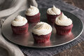 Silver platter of red velvet cupcakes with piped buttercream Royalty Free Stock Photos