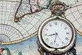 Silver pocket watch over old world map Royalty Free Stock Photo