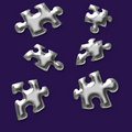 Silver puzzle pieces Stock Photography