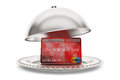Silver restaurant cloche with credit card on a white background Royalty Free Stock Photo