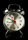 Silver retro alarm clock isolated on a black background Stock Image