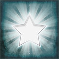 Silver rimmed star on aged light rays parchment Royalty Free Stock Photos