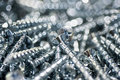 Silver Screws Macro Close Up. Background Pattern. Royalty Free Stock Photo