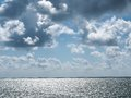 Silver sea bright clouds. Royalty Free Stock Photo