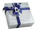 Silver shiny gift box paper wrap blue ribbon bow bell decoration isolated Royalty Free Stock Photo