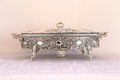 Silver tray beautifully ornate the kind one wants at home Stock Photo