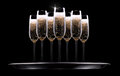 Silver tray with champagne glass on black background Stock Photo