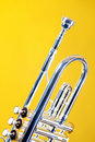 Silver Trumpet Isolated on Yellow Bk Royalty Free Stock Photos