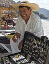Silver vendor playa las estacas mexico a talks to customers on a puerto vallarta beach Royalty Free Stock Photography