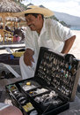 Silver vendor playa las estacas mexico a talks to customers on a puerto vallarta beach Stock Photography