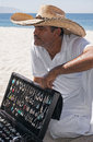 Silver vendor playa las estacas mexico a talks to customers on a puerto vallarta beach Royalty Free Stock Photo