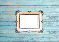Silver Vintage picture frame on blue wood Stock Photo