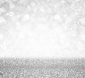 Silver and white bokeh lights defocused. abstract background Royalty Free Stock Photo