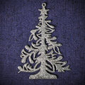 Silver xmas tree on blue canvas background Stock Photo