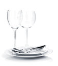 Silverware or flatware on plates and wine glasses white background Royalty Free Stock Photo