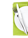 Silverware or flatware set of fork and knife over plate