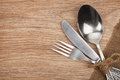 Silverware or flatware set of fork spoon and knife on wooden table Stock Image