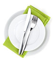 Silverware or flatware set of fork, spoons and knife on plates Royalty Free Stock Photo