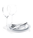 Silverware or flatware set over plates and wine glasses isolated on white background Stock Photography