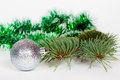 Silvery ball pine branch and green tinsel christmas Stock Images