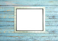 SilveVintage picture frame on blue wood background Royalty Free Stock Photo