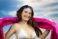 Similing girl in beachwear with towel and swimming goggles over blue sky Stock Photography
