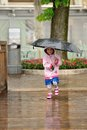 Simling in the rain a little girl having fun out Royalty Free Stock Photos