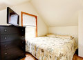 Simple attic bedroom interior. Horse ranch in Washington State Royalty Free Stock Photo