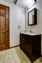 Simple bathroom interior with black cabinets and white sink Royalty Free Stock Photo