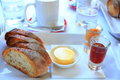 Simple breakfast served at cafe but yummy slices bread with butter and jams with coffee and tap water Royalty Free Stock Image