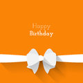 Simple card for birthday with a white paper bow on orange background your design Royalty Free Stock Photo