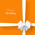 Simple card for birthday with a white paper bow on orange background your design Stock Photography