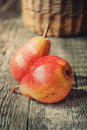 Simple composition with two red pears on wooden table toned warm Stock Photography