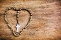 Simple Cross Inside Heart Shape - Rustic Royalty Free Stock Photo