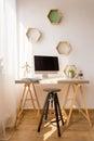 Simple desk and black stool