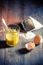 Simple dessert made ​​of egg yolks and sugar on old wooden table Royalty Free Stock Photos
