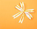 Simple elegant ribbon on orange carton background Royalty Free Stock Photo