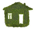 Simple house from green moss isolated on white background Royalty Free Stock Photo