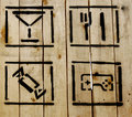 Simple icons on wooden background Royalty Free Stock Image