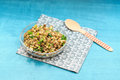 Simple lentil salad with pickles, parsley, and pasta on turquois Royalty Free Stock Photo