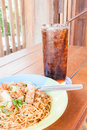 Simple meal with stir fried spicy noodles and cola Stock Image
