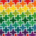Simple modern rainbow colored repeating background with a structure of colorful crosses Royalty Free Stock Photo