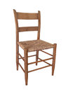 Simple old wooden chair isolated low back unpainted with a woven cane seat on white Royalty Free Stock Image