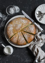 Simple orange cake with olive oil on a dark stone background. Royalty Free Stock Photo
