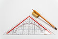 Simple pencil eraser and ruler triangle a on a light background Royalty Free Stock Photo